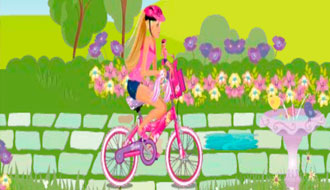 Барби на велосипеде